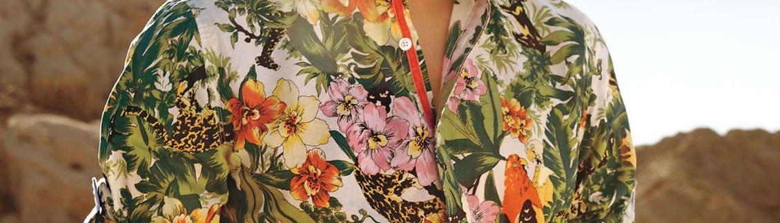 close up of mens bright green and pink hawaiian shirt in the sunshine - ideal non-safari wear