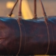 Close up of brown leather holdall in centre of tarmacced road