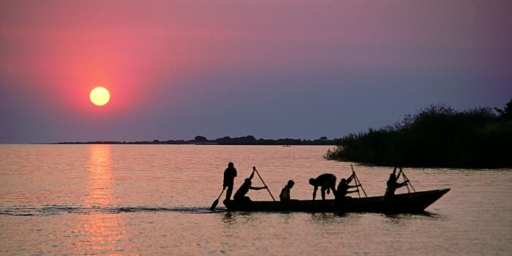 Lake albert, uganda at sunset. Small boat in foreground