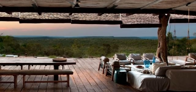 View from safari lodge interior to green forest beyond