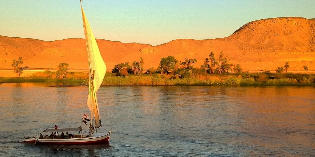 A felluca floats down the Nile River - one of the seven african natural wonders